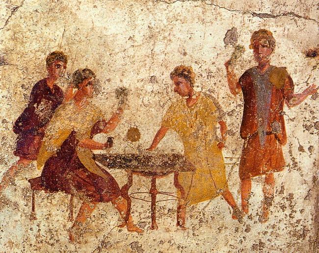 משתה בסטורנליה. ציור קיר מפומפיי. באדיבות Wikipedia