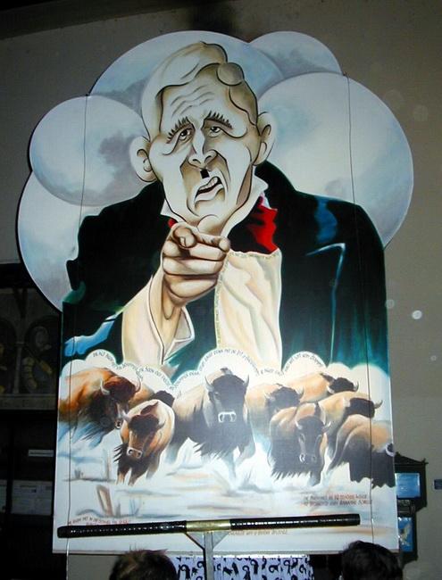 כרזה היתולית של ג'ורג' בוש. הקרנבל של באזל. באדיבות Wikipedia